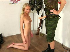 Lesbian sergeant drills a soldier in a breather