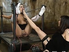 Exotic Asian beauty is made to worship Princess Donnas feet and suffer the sting of her electrical gadgets